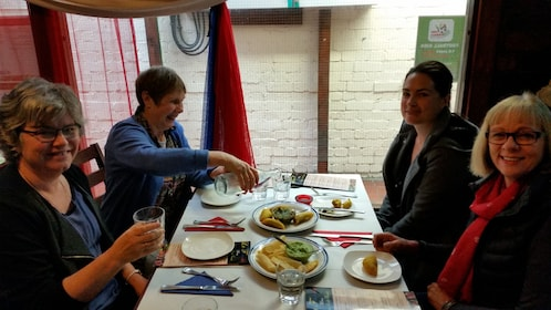 Group of four enjoying a meal in Wellington