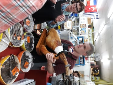 Group learning about Wellington's diverse food culture inside a shop