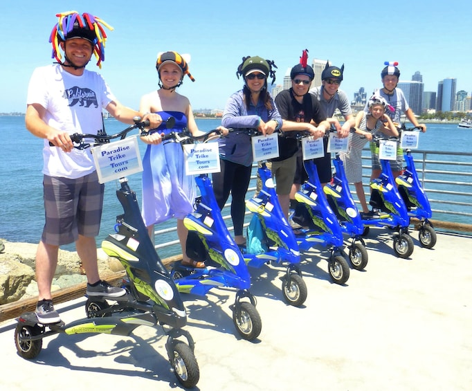 Show item 1 of 5. Group riding trikes in San Diego