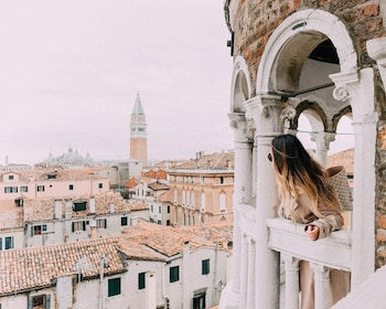 Woman looking out the Palazzo Contarini del Bovolo