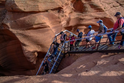 Tour group descending staircase to Lower Antelope Canyon