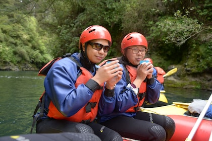 Close up of guests on a white water rafting adventure in Tongariro River