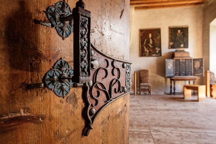 Show item 4 of 4. Wooden door opens into a room in Tratzberg Castle