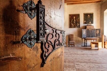 Wooden door opens into a room in Tratzberg Castle