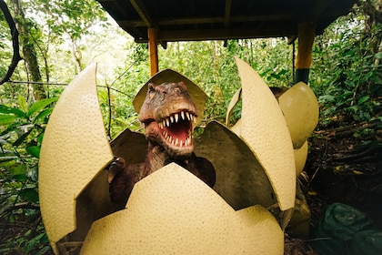 A dinosaur hatching out of an egg at the Dino Park at the Blue River Resort and Hot Springs Hotel in Liberia