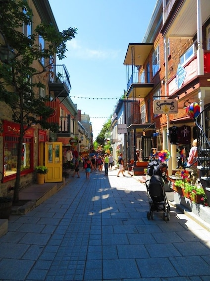 Show item 4 of 6. Pedestrian street lined with shops in Quebec