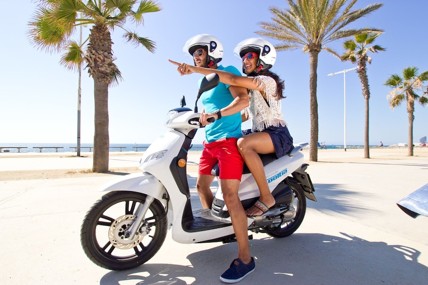 Ver elemento 2 de 5. Couple driving a scooter in Menorca