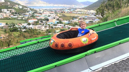 Young boy on an inner tube slide in St. Barthelemy