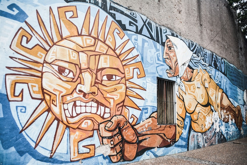 Show item 2 of 4. Mural of a man and sun in Buenos Aires