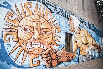 Mural of a man and sun in Buenos Aires