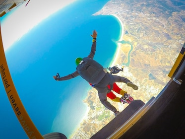 Skydivers jump out of a plane