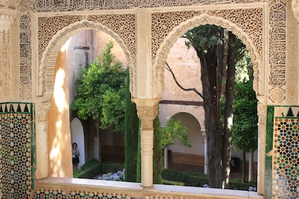 Windows looking out at a terrace at Alhambra Palace in Granada