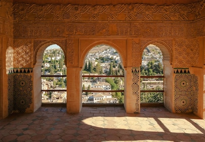 View through arches of surrounding city at Alhambra Palace in Granada