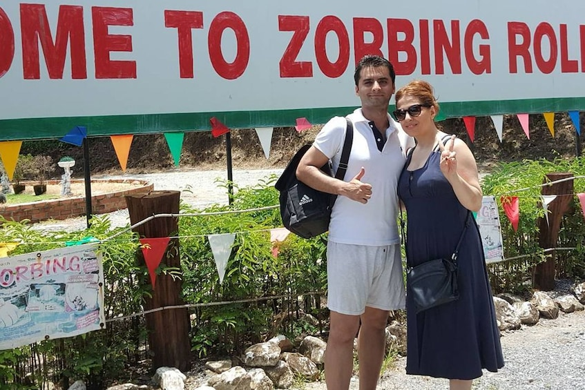 Show item 2 of 5. Couple about to go zorbing in Phuket