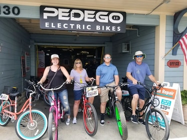 Group on bikes in front of Pedego Electric Bikes in Carlsbad