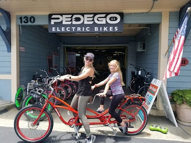 Ladies riding a tandem bicycle in Carlsbad