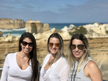 Three women wearing sunglasses while on the Great Ocean Road tour