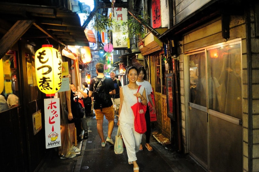 Show item 1 of 8. Neon lights in a small alleyway in Shinjuku