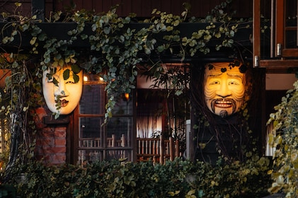 Two carved faces in front of a building in Taipei