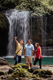 Group taking a selfie in front of a waterfall in Taipei