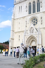 Visitors taking photos in front of Zagreb Cathedral