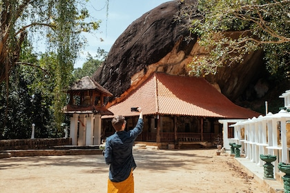 Man takes photo of a temple in Sri Lanka