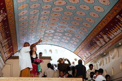 Tourists taking photos of the beautiful artwork in Sri Lanka