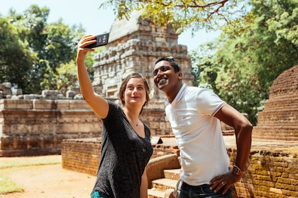 Visitors taking a selfie at Dambulla cave temple