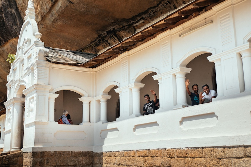 Show item 3 of 10. Visitors at Dambulla cave temple in Sri Lanka
