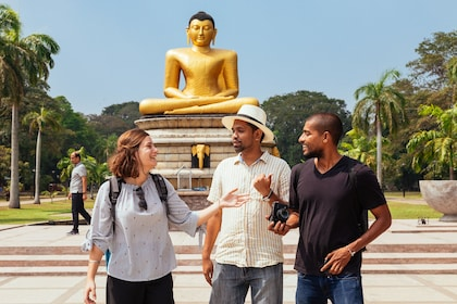 Tour group at golden Buddha statue in Colombo