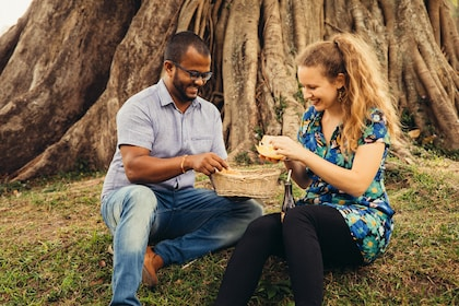 Couple with basket of food in a park in Colombo