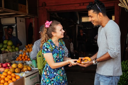 Tour group sampling fruit at a fruit market in Colombo