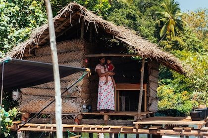 Local woman with child in a floating hut in Galle