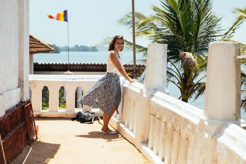 Tourist enjoying a view of the water from a balcony in Galle