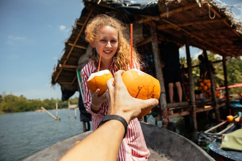 Coconut drinks on a boating tour in Galle