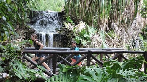 People cross a bridge in Mayan Laser Tag Adventure