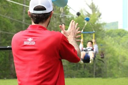 Guide applauds guest ziplining in Ledyard