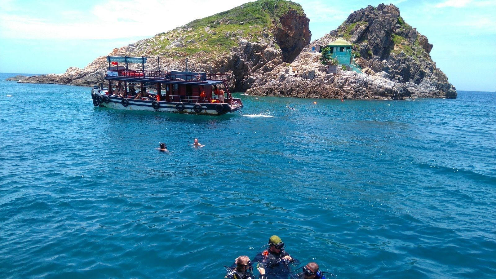 Snorkelers and divers near boat off the coast of Nha Trang