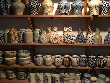 Jars and vases on a cabinet at a ceramics factories in Puebla