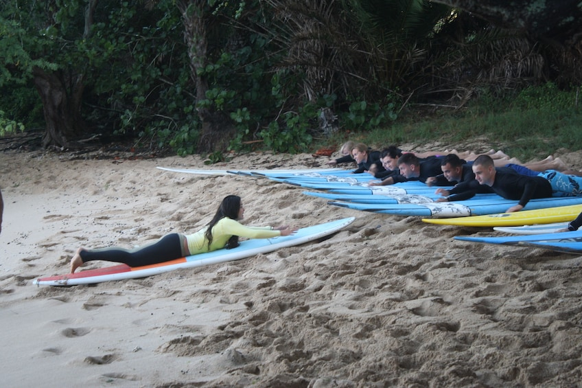 Instructor teaching a group how to surf in Haleiwa