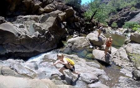 Group climbing on rocks at a lake in Marmaris