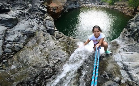 Young girl abseiling down a waterfall in Marmaris