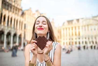 Woman holding chocolate on the Brussels Food and Drinks Delicious Tour