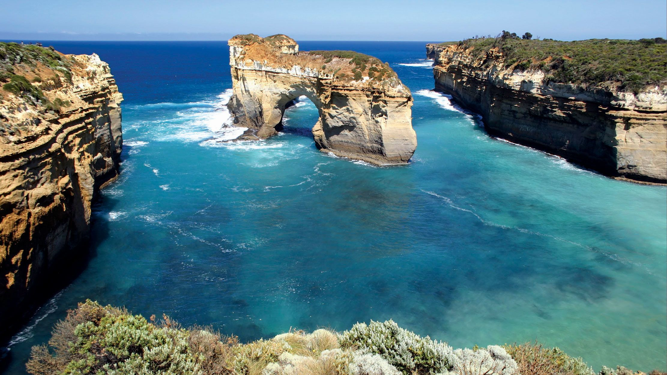Naturally formed rock archway in the water in Australia