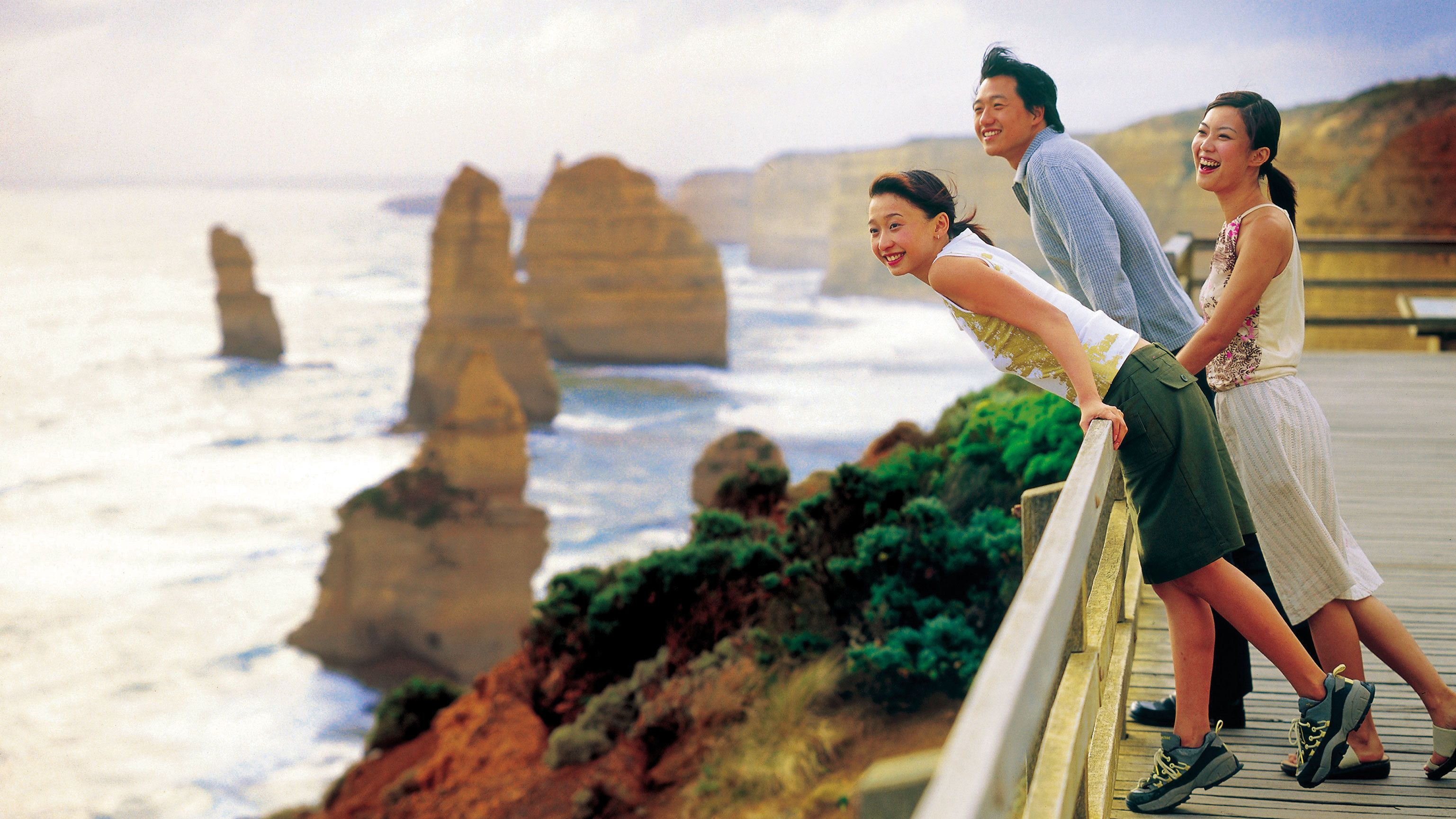 Visitors looking out to the sea from the cliffside in Australia