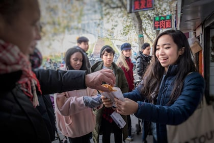 Group trying street food on a food tour in Shanghai