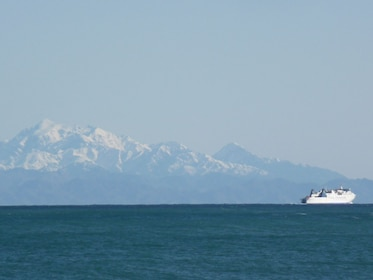 Mountain and Ferry off the Wellington coast