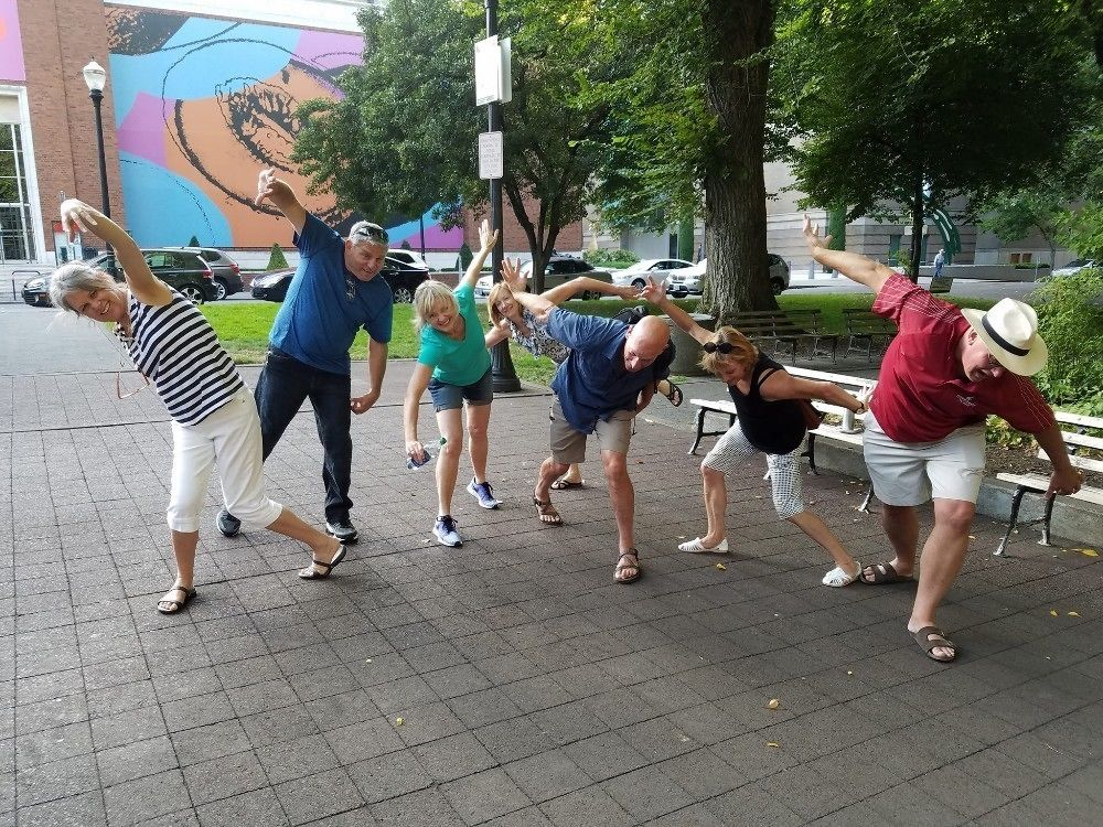 Group on a scavenger hunt posing in funny positions