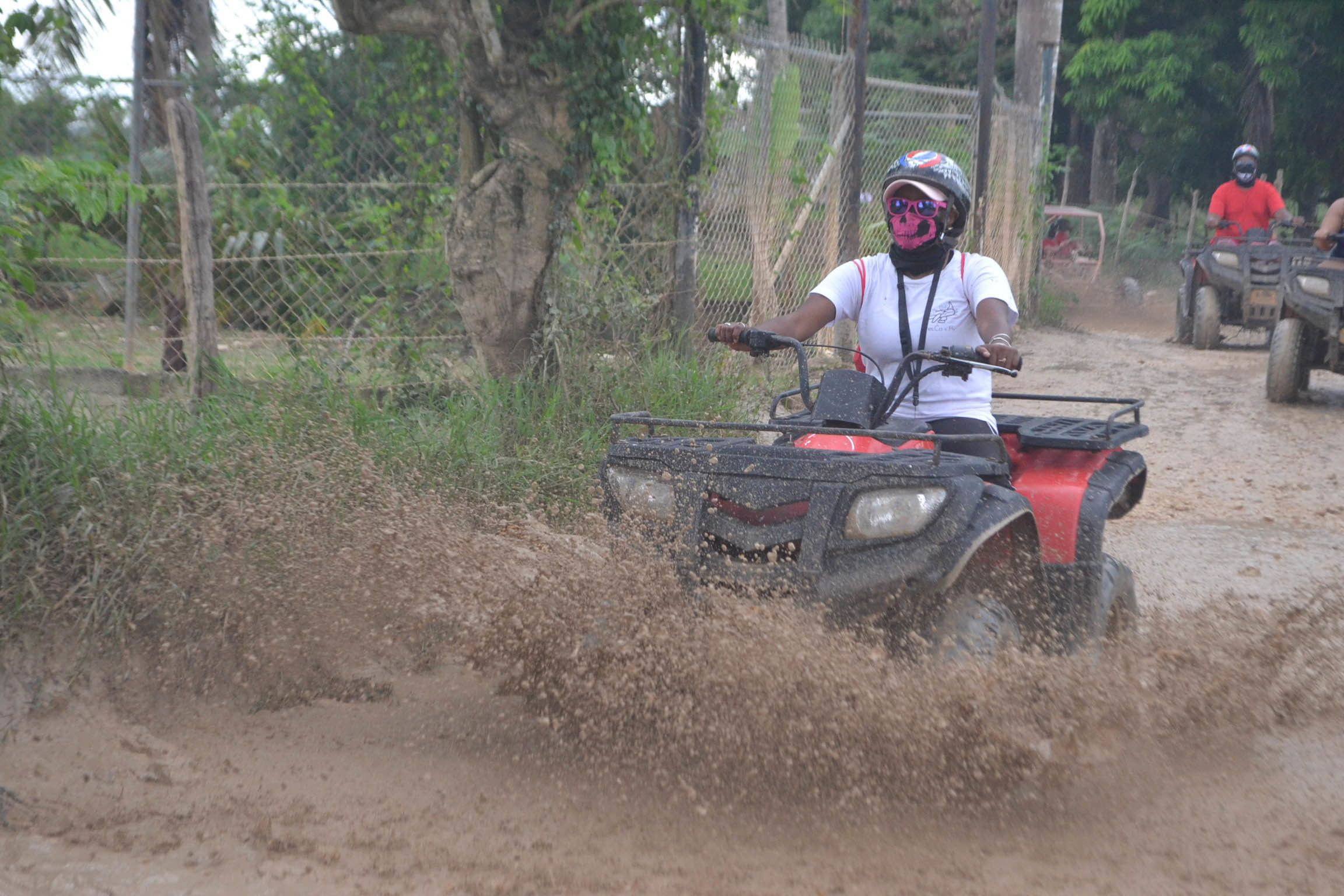 Woman riding an ATV in the mud in Punta Cana