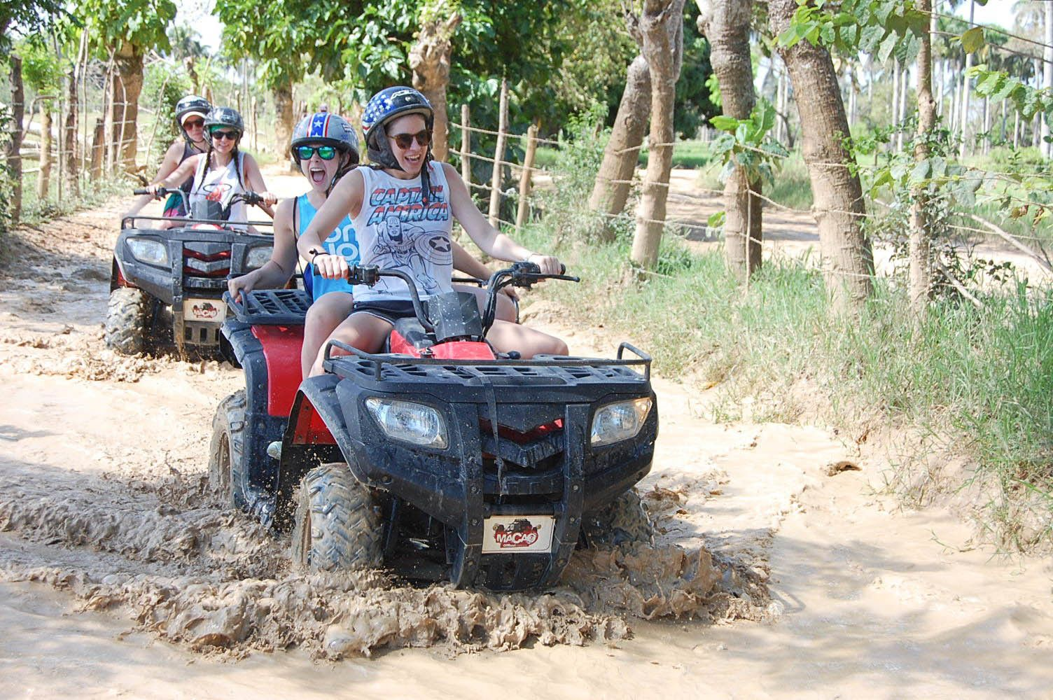 People driving ATVs through the mud in Punta Cana